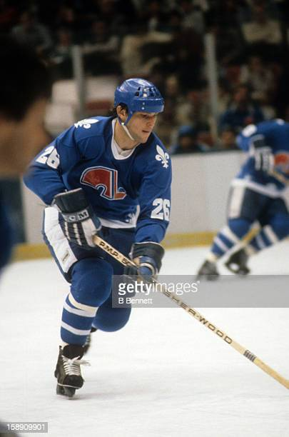 Peter Stastny of the Quebec Nordiques skates with the puck during an NHL game against the New York Islanders on December 20 1980 at the Nassau...