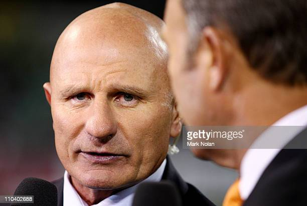 Peter Sterling talks with Wally Lewis before the round two NRL match between the Canberra Raiders and the Brisbane Broncos at Canberra Stadium on...
