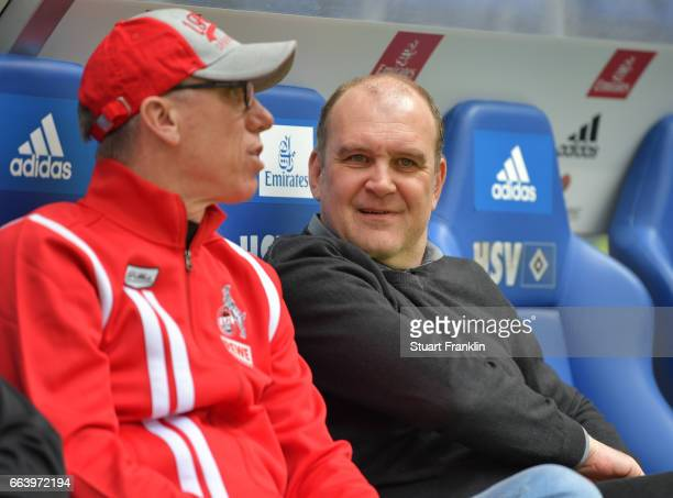 Peter Stger head coach of Cologne talks with Joerg Schmadtke sports director of Cologne during the Bundesliga match between Hamburger SV and 1 FC...