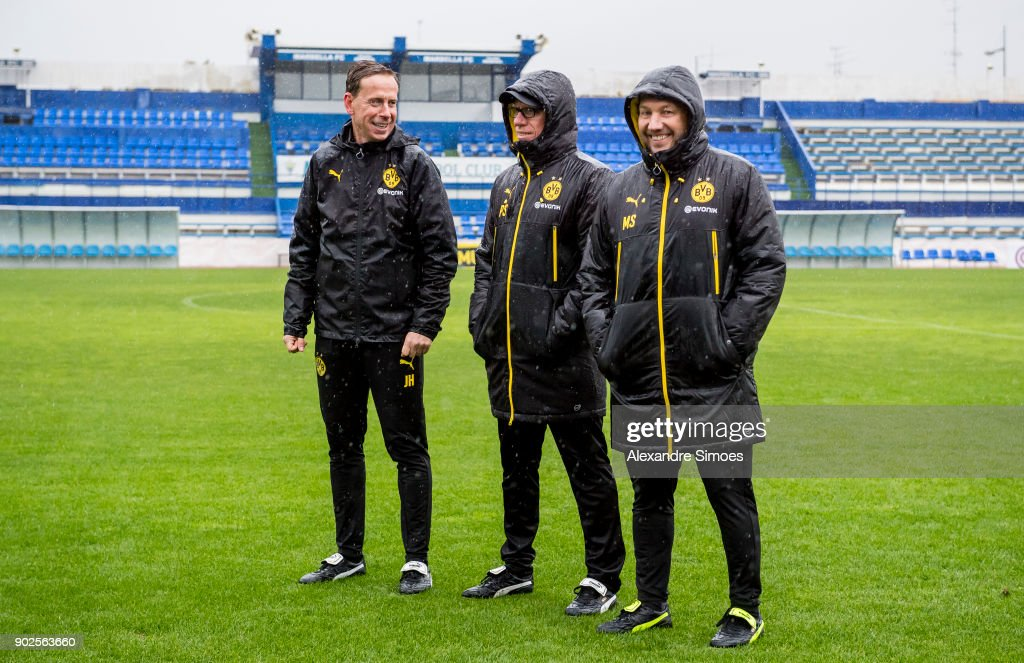 Peter Stoeger, head coach of Borussia Dortmund, and his assistant coaches Joerg Heinrich and Manfred Schmid during a rainy training session as part of the training camp at the Estadio Municipal de Marbella on January 08, 2018 in Marbella, Spain.
