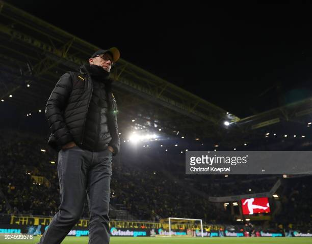 Peter Stoeger head coach of Dortmund stands in front of an almost empty south stand that normally holds 26000 fans as the fans make their protest...