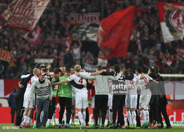 Peter Stoeger head coach of Koeln celebrates with his players after the Bundesliga match between 1 FC Koeln and Werder Bremen at RheinEnergieStadion...