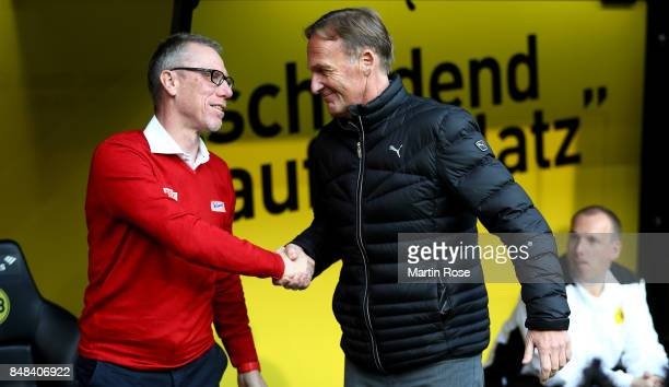 Peter Stoeger head coach of Koeln talks to Hans Joachim Watzke CEO of Dortmund before the Bundesliga match between Borussia Dortmund and 1 FC Koeln...