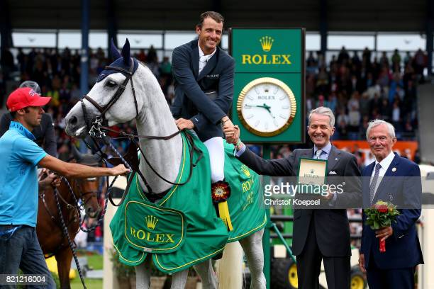 Peter Streit Rolex Germany hands out the winning trophy with Carl Meulenbergh president of AachenLaurensberger Rennverein to Gregory Wathelet of...