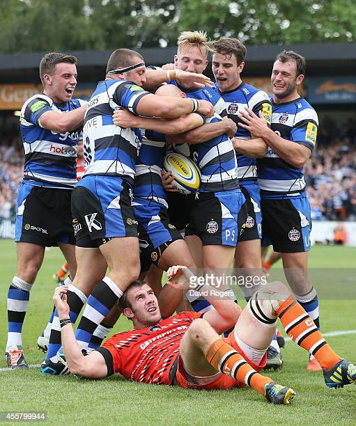 Peter Stringer of Bath is mobbed by team mates after scoring a try leaving Tom Croft of Leicester on the ground during the Aviva Premiership match...