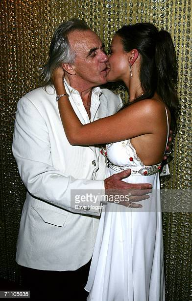Peter Stringfellow and his girlfriend Bella Wright kiss as they attend the launch of the latest Stringfellow's lap dancing club 'Stringfellows Soho'...