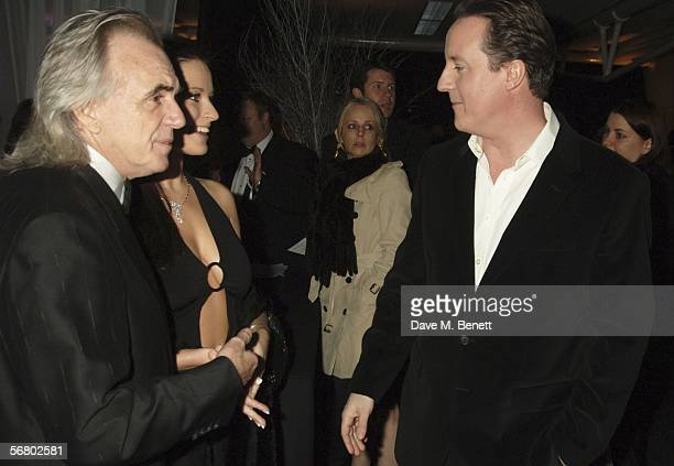 Peter Stringfellow Bella Wright and David Cameron attend the Conservative Party Black White Ball at Old Billingsgate Market on February 8 2006 in...