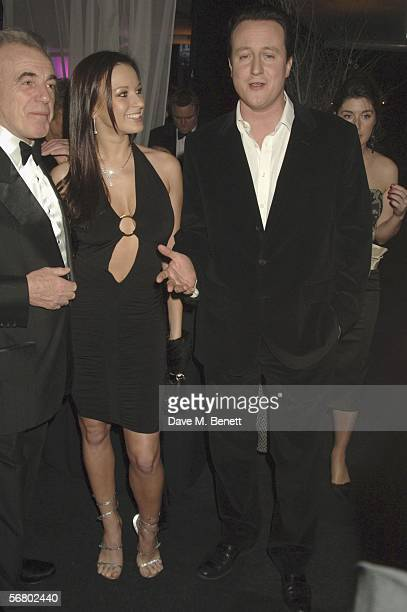 Peter Stringfellow girlfriend Bella Wright and Leader of the Conservative Party David Cameron attend the Conservative Party Black White Ball at Old...