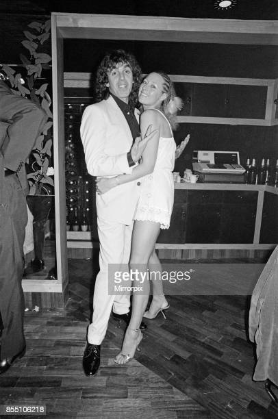 Peter Stringfellow, owner of the new nightclub Stringfellows in Covent Garden, pictured at the nightclub with a guest. London, 1st August 1980.