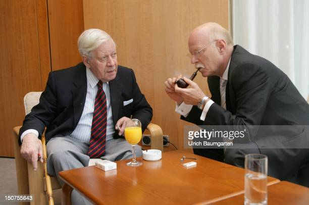 Peter STRUCK Defence Minister and Helmut SCHMIDT chancellor aD on a reception on the occasion of 50 years of Bundeswehr in Bonn STRUCK has invited...