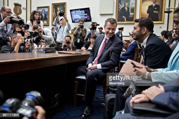 Peter Strzok an agent at the Federal Bureau of Investigation center waits to begin a joint House Judiciary Oversight and Government Reform Committees...