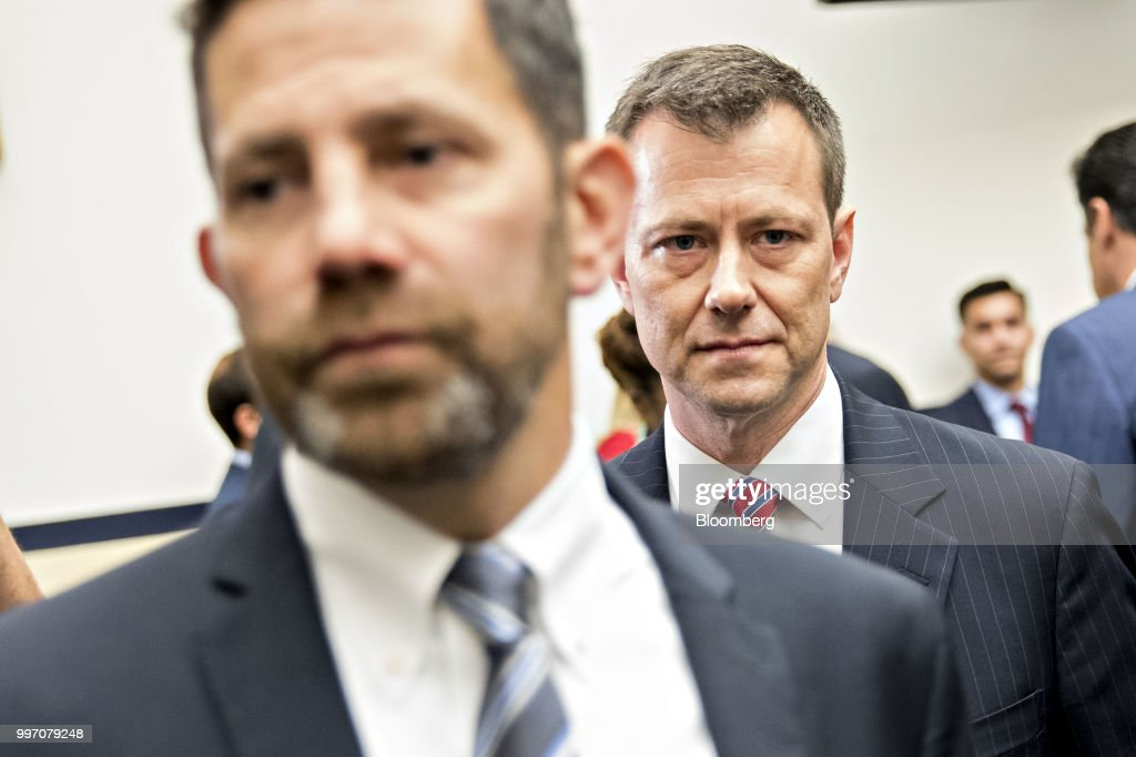 Peter Strzok, an agent at the Federal Bureau of Investigation (FBI), right, arrives to a joint House Judiciary, Oversight and Government Reform Committees hearing in Washington, D.C., U.S., on Thursday, July 12, 2018. Strzok, the FBI agent who exchanged anti-Trump texts with a bureau lawyer, denied he did anything improper, as he faced a hearing called by Republican lawmakers who say he personifies bias that tainted the agency's Russia investigation early on. Photographer: Andrew Harrer/Bloomberg via Getty Images