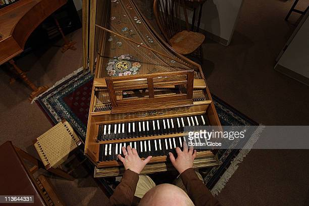 Peter Sykes is a piano/harpsicord/clavicord collector Photographed with his collection at First church of Cambridge he is also playing one of the...