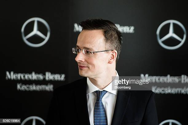 Peter Szijjarto, Hungary's minister of foreign affairs and trade, looks on during a groundstone laying ceremony at the Mercedes-Benz AG automobile...
