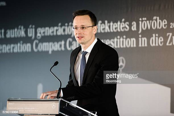 Peter Szijjarto, Hungary's minister of foreign affairs and trade, speaks during a groundstone laying ceremony at the Mercedes-Benz AG automobile...
