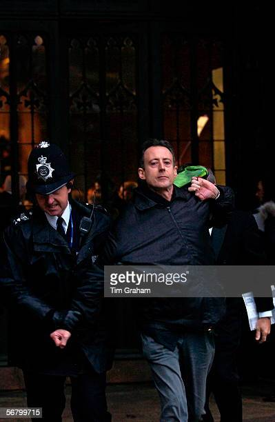 Peter Tatchell being escorted from Westminster Hall by police security after demonstrating for gay rights at a service to mark the National...