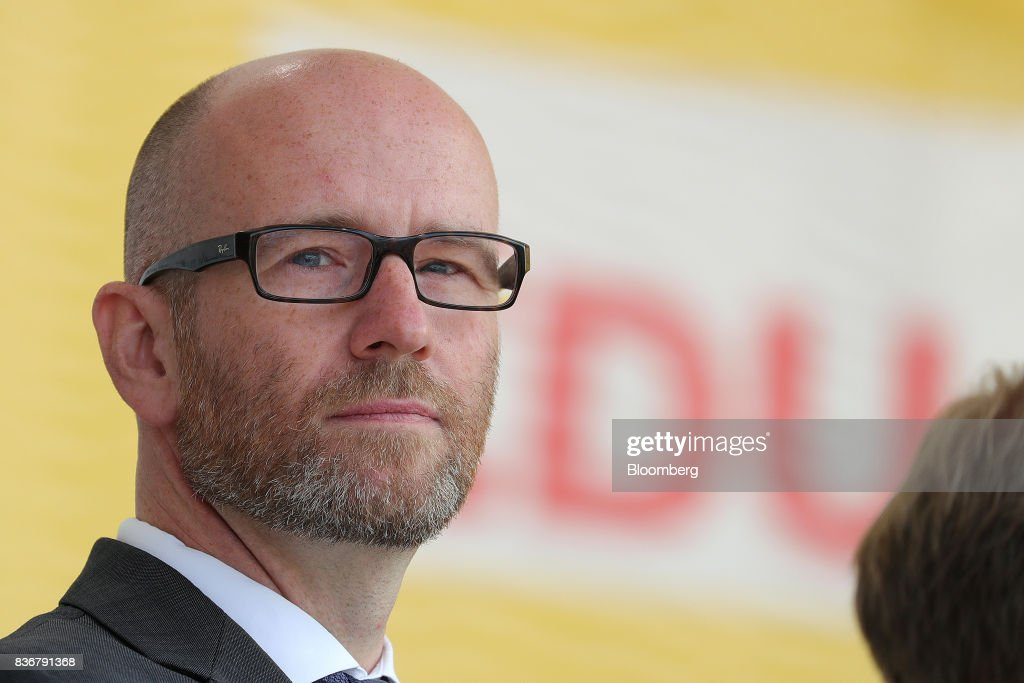 Peter Tauber, Christian Democrat Union (CDU) general secretary, looks on during an election campaign stop in Saint Peter-Ording, Germany, on Monday, Aug. 21, 2017. Germany's Chancellor and CDU leader Angela Merkel headed out on the campaign trail last week and quickly faced disruption by anti-immigration demonstrators, a reminder that the refugee crisis that sent her popularity plunging in 2016 remains a residual risk. Photographer: Krisztian Bocsi/Bloomberg via Getty Images