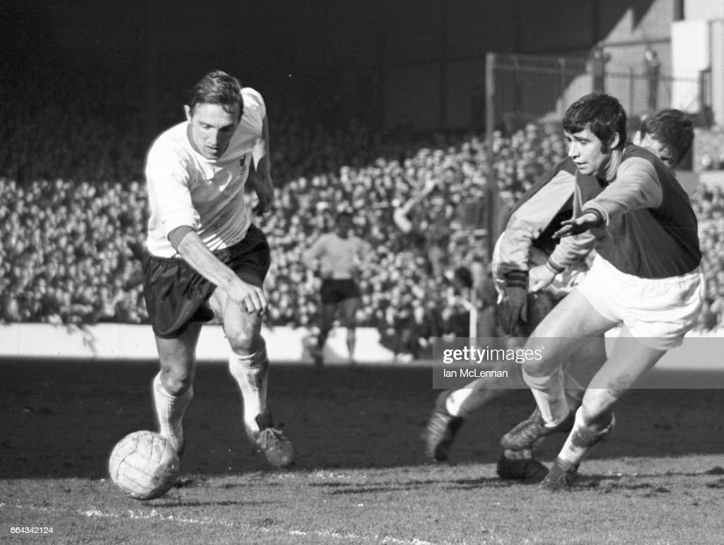 Peter Thompson of Liverpool and Ronnie Boyce of West Ham, in the Football League Division 1, at Upton Park London on 22nd February 1969.
