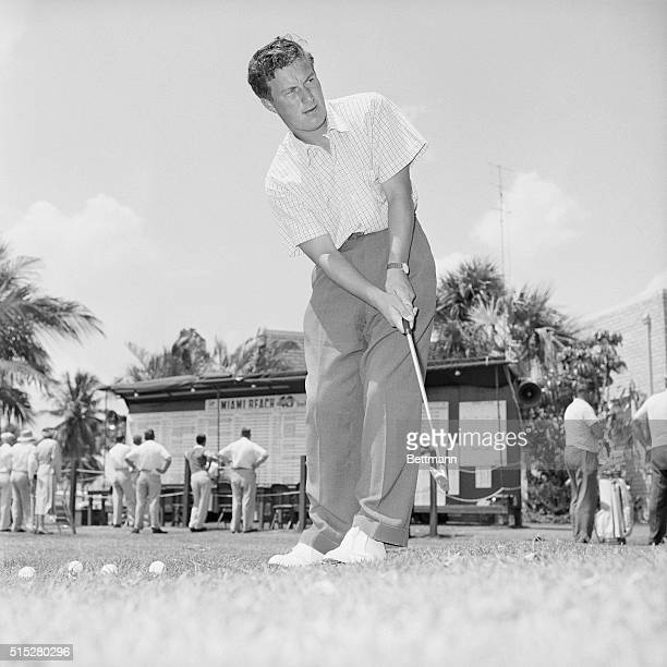 Peter Thomson Australian golfer and one of the leaders in the Miami Beach Open golf tournament putting during the tournament