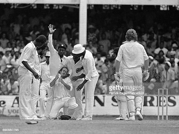 Peter Toohey of Australia is assisted by Viv Richards of West Indies after being hit during the 1st Test match between West Indies and Australia at...