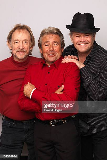 Peter Tork Davey Jones and Micky Dolenz of The Monkees pose during portrait session to announce the bands 45th anniversary tour held at The Groucho...