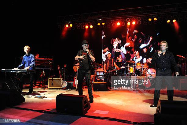 Peter Tork Mickey Dolenz and Davy Jones of The Monkees perform at Pompano Beach Amphitheatre on June 5 2011 in Pompano Beach Florida