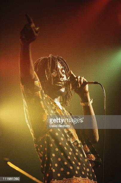 Peter Tosh Jamaican reggae musician singing into a microphone during a concert circa 1975