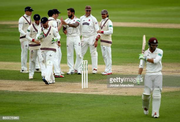 Peter Trego of Somerset celebrates with his teammates after dismissing Ben Foakes of Surrey during day two of the Specsavers County Championship...