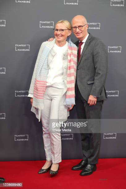 Peter Tschentscher and Eva-MariaTschentscher attend the Hamburg film festival opening with the premiere of the movie Enfant terrible on September 24,...