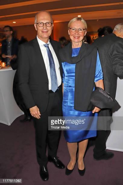 Peter Tschentscher and his wife Eva-Maria Tschentscher attend the Hamburg Film Festival Opening at Cinemaxx Dammtor on September 26, 2019 in Hamburg,...