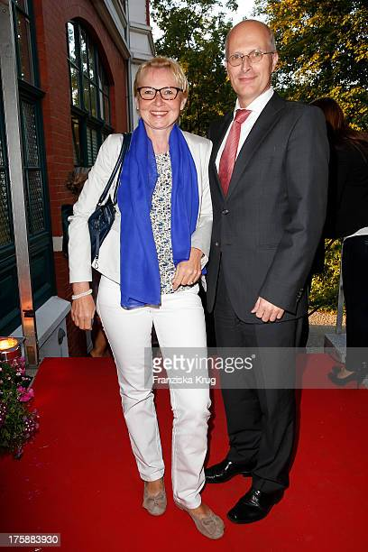 Peter Tschentscher and his wife Eva-Maria Tschntscher attend the 'Nacht der Medien 2013' on August 09, 2013 in Hamburg, Germany.