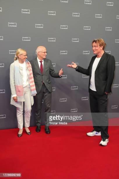 Peter Tschentscher, Eva-MariaTschentscher and Oliver Masucci attend the Hamburg film festival opening with the premiere of the movie Enfant terrible...