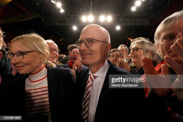 Peter Tschentscher mayor of the northern German City of Hamburg and his wife EvaMaria Tschentscher make their way through members of the German...