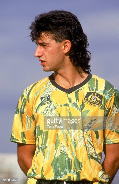 Peter Tsekinis of the Young Socceroos looks on during the singing of the National Anthem before the start of a soccer match between Australia and...