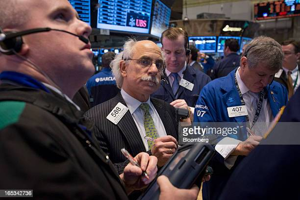Peter Tuchman a trader with Quattro M Securities Inc center works amongst other traders on the floor of the New York Stock Exchange in New York US on...