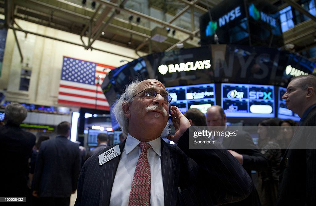 Peter Tuchman, a trader with Quattro M Securities Inc., works on the floor of the New York Stock Exchange (NYSE) in New York, U.S., on Monday, Feb. 4, 2013. U.S. stocks fell, after the Standard & Poor's 500 Index jumped to a five-year high, on concern over increasing political tension in Europe as investors awaited data on factory orders. Photographer: Jin Lee/Bloomberg via Getty Images