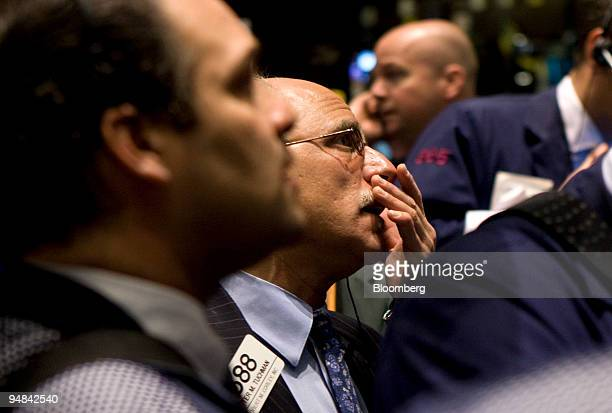 Peter Tuchman center works on the floor of the New York Stock Exchange in New York US on Wednesday Dec 3 2008 US stocks tumbled as an industry report...