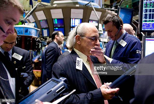 Peter Tuchman center works on the floor of the New York Stock Exchange in New York US on Monday Feb 23 2009 US stocks drifted between gains and...