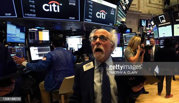 Peter Tuchman, floor trader, reacts as he works on the floor during the opening bell on the New York Stock Exchange on March 9, 2020 in New York. -...