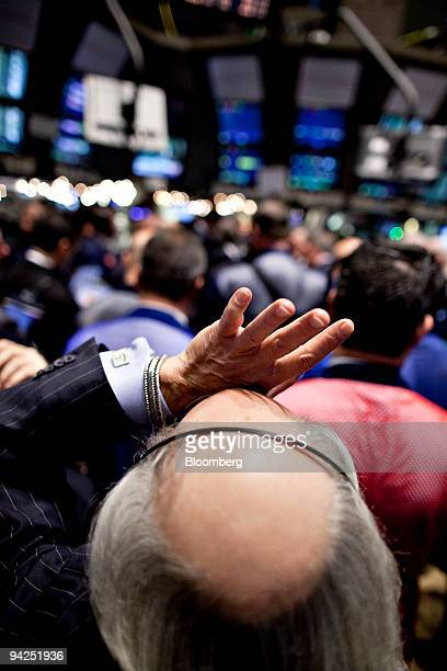 Peter Tuchman holds his hand to his forehead as he waits for the start of trading of CIT Group Inc shares at the New York Stock Exchange in New York...