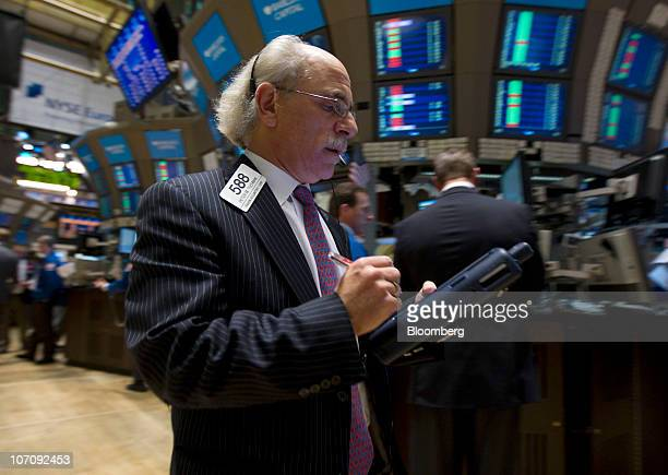 Peter Tuchman of Raven Securities Corp works on the floor of the New York Stock Exchange in New York US on Tuesday Nov 23 2010 Photographer Jin...