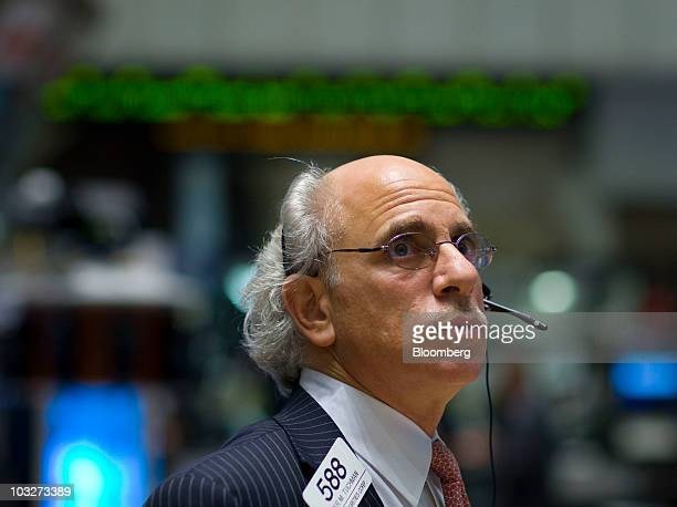 Peter Tuchman works on the floor of the New York Stock Exchange in New York US on Friday Aug 6 2010 Stocks and the dollar dropped and Treasuries...