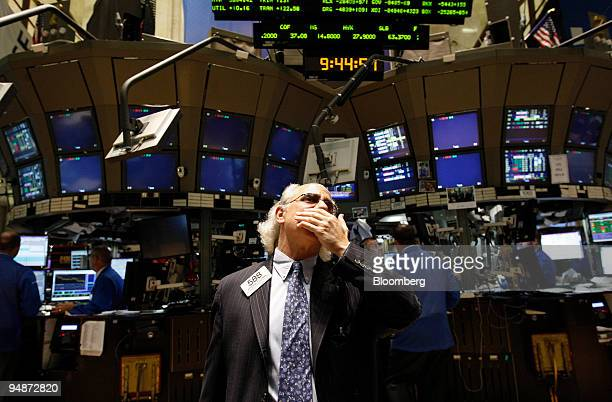 Peter Tuchman works on the floor of the New York Stock Exchange in New York US on Monday Oct 13 2008 Stocks rallied worldwide with the Standard Poors...