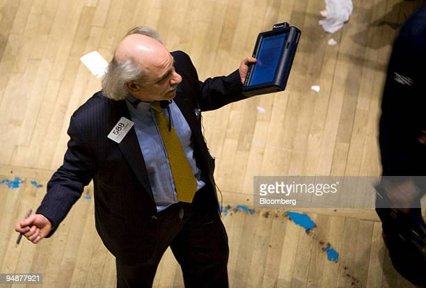 Peter Tuchman works on the floor of the New York Stock Exchange in New York US on Friday March 14 2008 US stocks plunged for the third day this week...