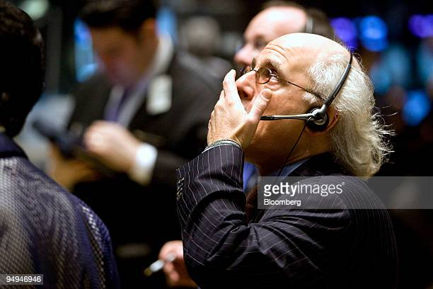 Peter Tuchman works on the floor of the New York Stock Exchange in New York US on Friday Feb 13 2009 US stocks fell extending the markets weekly...