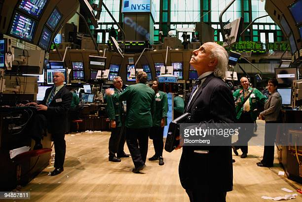 Peter Tuchman works on the floor of the New York Stock Exchange shortly before the Federal Open Market Committee's rate cut decision was announced in...