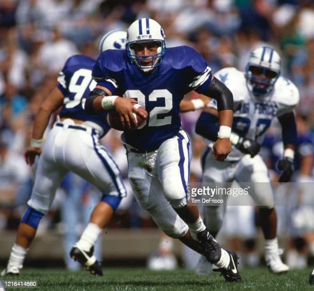 Peter Tuipulotu, Running Back for the Brigham Young University Cougars runs the ball during the NCAA Western Athletic Conference college football...