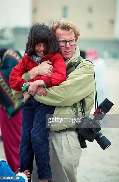 Peter Turnley Holding a Kuwaiti Girl