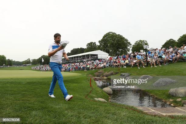 Peter Uihlein acknowledges the gallery as he walks off the 18th green during the third round of the 2018 Wells Fargo Championship at Quail Hollow...