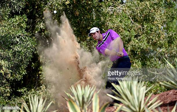 Peter Uihlein of the USA plays his third shot on the far five 2nd hole during the third round of the Abu Dhabi HSBC Golf Championship at the Abu...